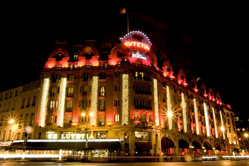Brightful red lights decoration on the facade of the famous art deco Hotel Lutetia Rive Gauche in Paris celebrating its 100 years | by Concorde Hotels Resorts