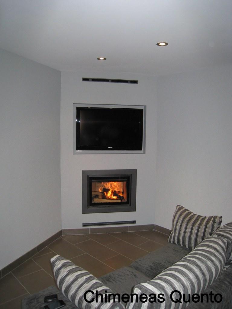 Chimenea quento en esquina integrando television con hoga - Chimeneas en esquina ...