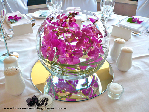Pink orchid fishbowl wedding reception table flowers a