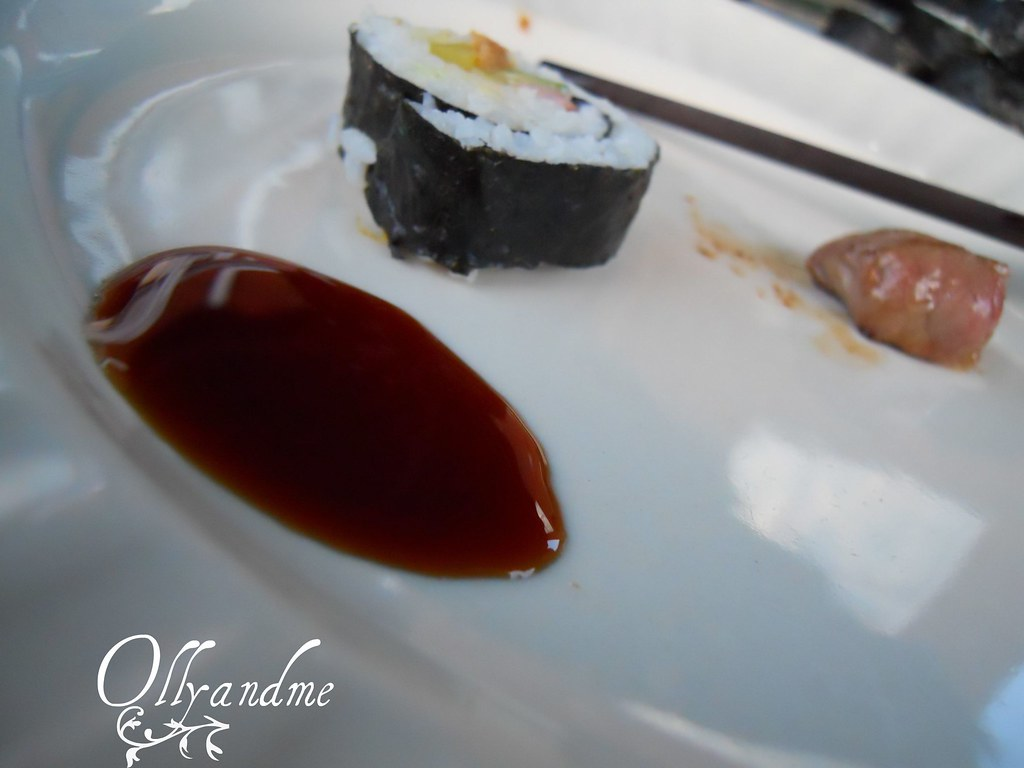 Sushi sushi soy sauce and a piece of meat asian food for Adaro sushi pan asian cuisine