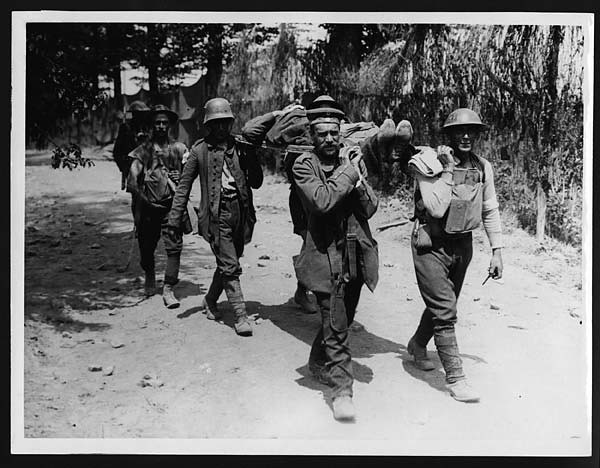 German prisoners helping British Tommies bring in the wounded near