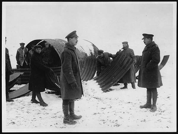 Building A Nissen Hut In The Snow Men Lifting The Curved