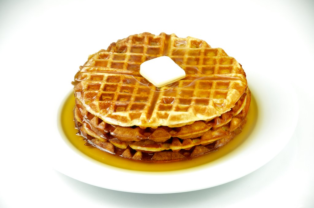 Waffles | Waffles with maple syrup and butter on a white pla ...