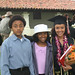 Graduates with family and friends after ceremony