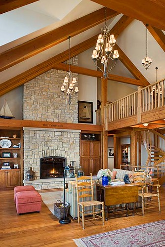 the tuscany iii timber frame home great room by riverbend timber framing