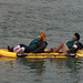 Two Interesting Ladies Lean Back in a Dual Kayak