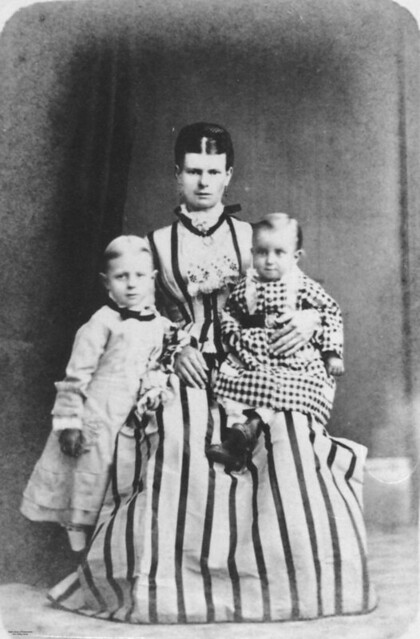 Mother And Two Children Posing For A Portrait 1870 1880