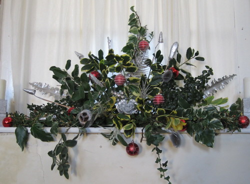 christmas flower arrangement by designs by katie
