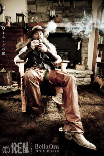 cowboy smoking a pipe in his living room