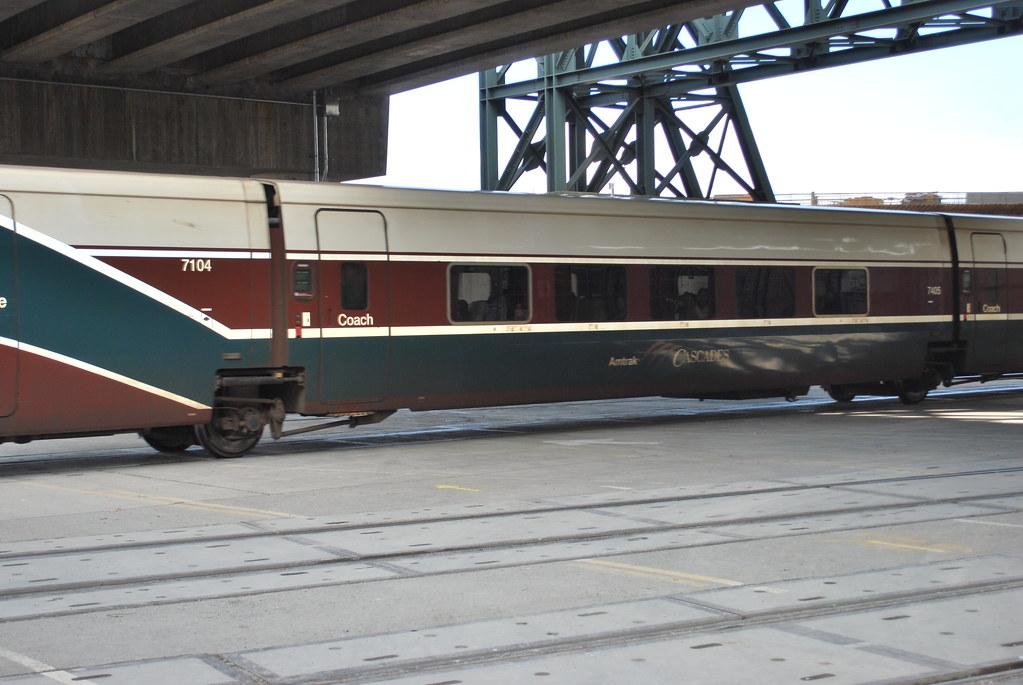 amtrak cascades a cascades coach car on a train passing