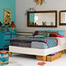 turquoise dresser and red lamp
