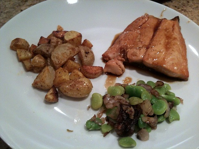 Dinner: salmon with potatoes and fava beans sauteed with s ...