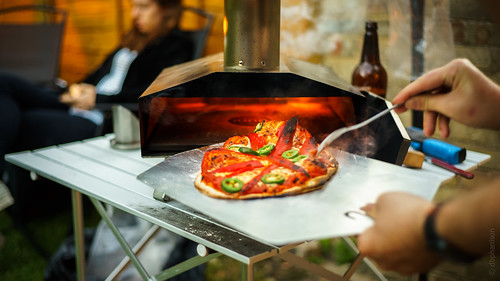 Cooked pizza coming out of the Uuni Pizza Oven | by DBP Harrison