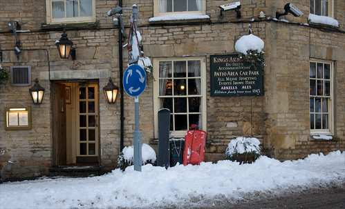 Sledges and snowboard parked at the pub | by Simon Clayson