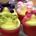 Cup cakes by Cotton and Crumbs with hand tied bows and ribbons
