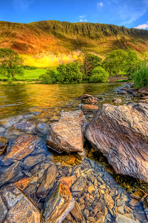 Rocks of Tal y LLyn lake | by DJKphotography