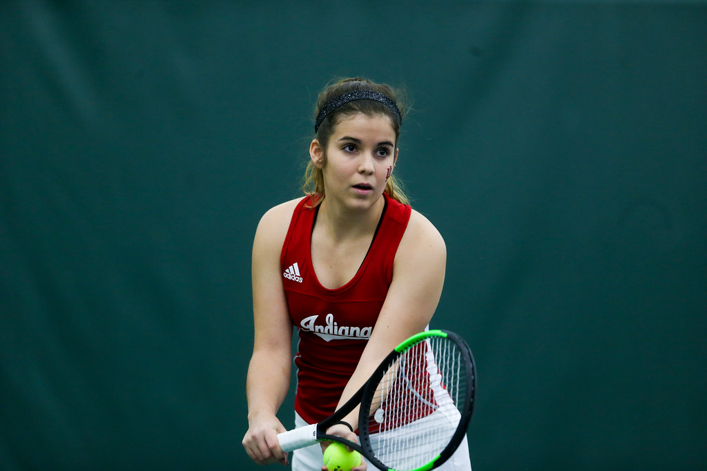 Paula Gutierrez of the Indiana University Hoosiers prepares to serve during her doubles match.