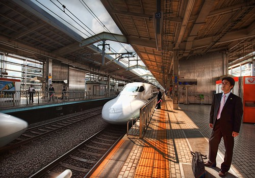 Salaryman waiting on the Bullet Train | by Stuck in Customs