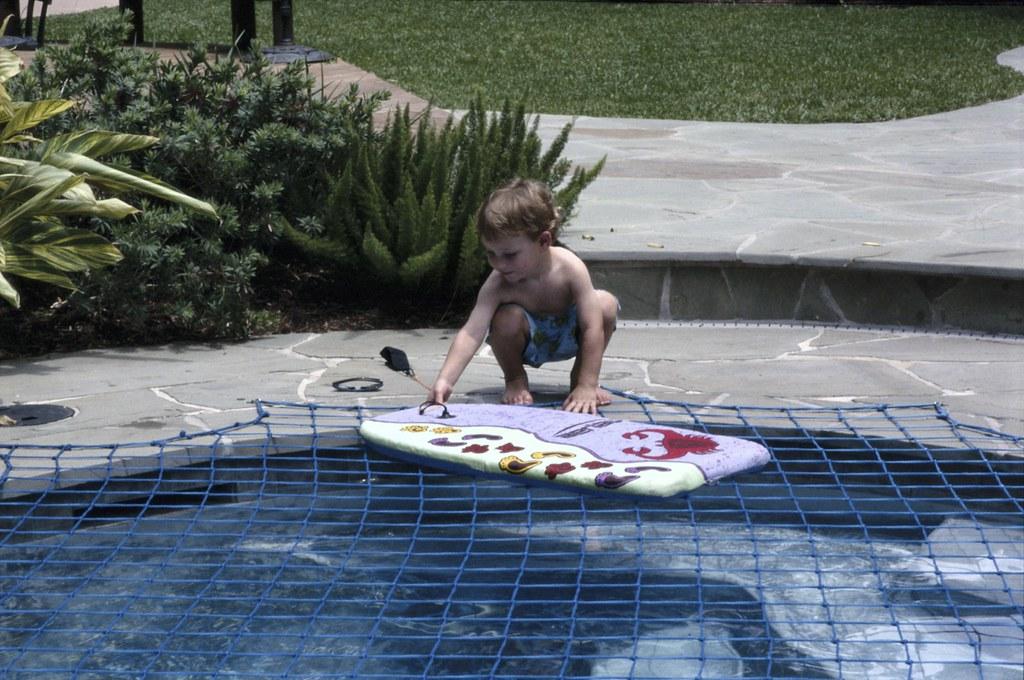 Katchakid pool safety net cover in ocean blue. | Meticulousl ...