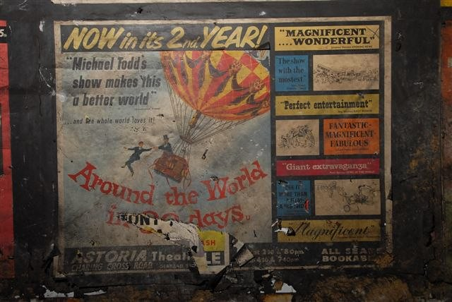 """Around the World in Eighty Days"", movie film poster from 1956 as found in disused area of Notting Hill Gate tube station, London, 2010"