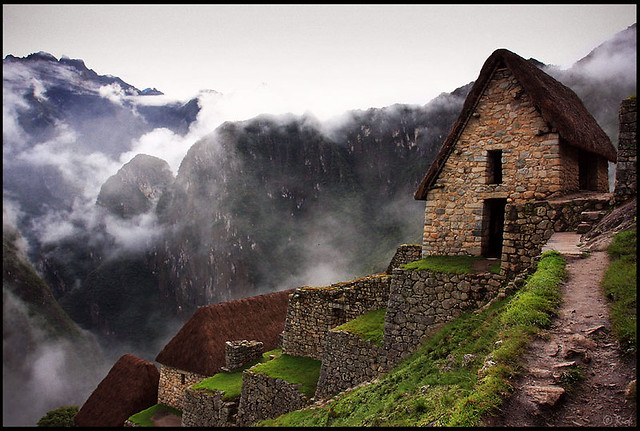 Storage Huts And Andean Mountains In Dense Fogs Machu