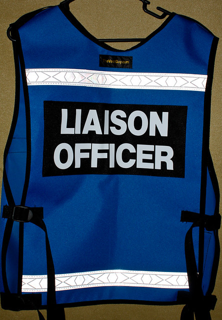 What is the role of a liaison officer?