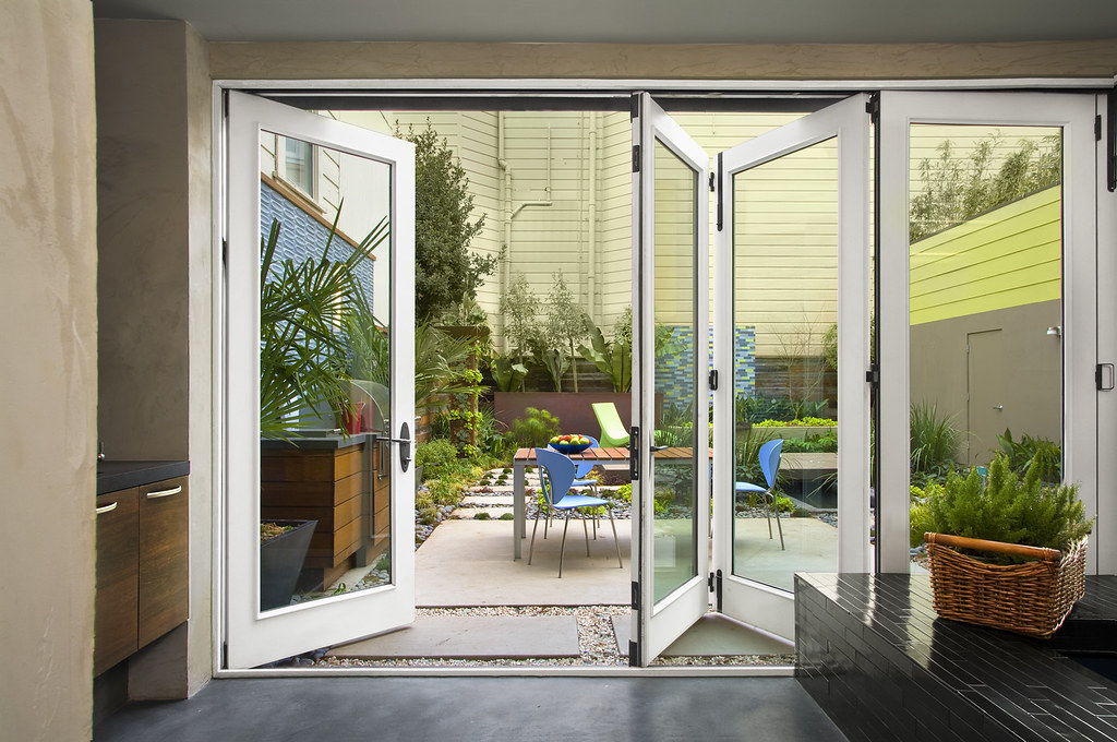 Patio with jeld wen custom folding patio doors bifold by for Custom patio doors