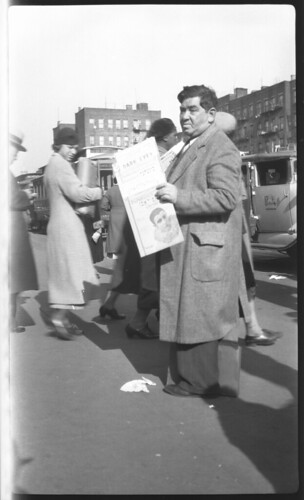 Man selling Yiddish song sheets at Northeast corner of Essex and Delancey Streets, New York. | by Center for Jewish History, NYC