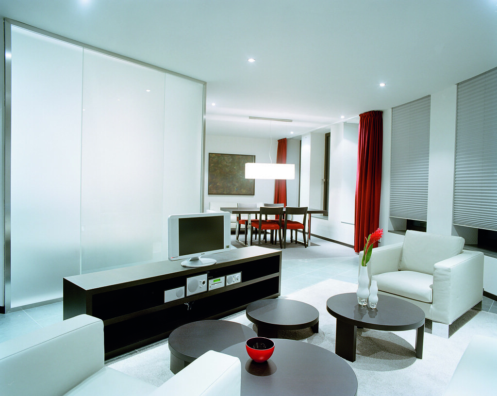 White modern spacious trendy futuristic living room of the for Trendy living room