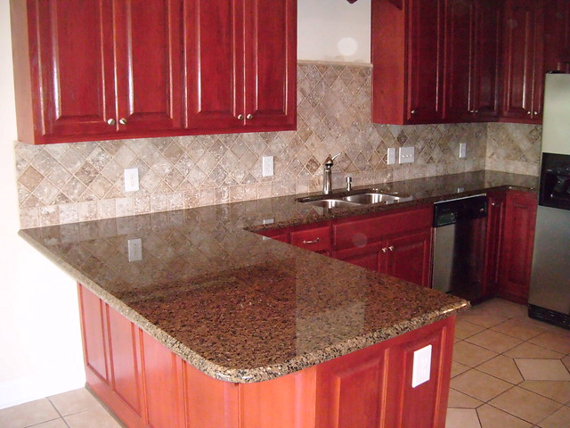 Cherry Kitchen Cabinets With Black Granite
