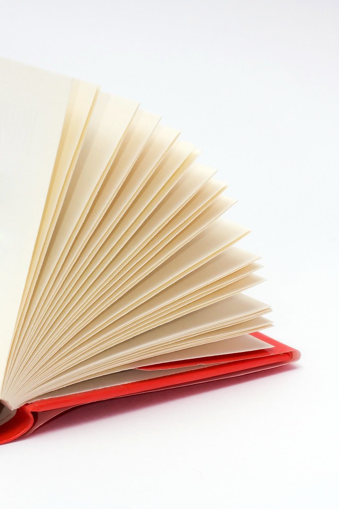 red hardcover book with flipping pages small sized