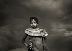 Pokot girl with necklace under a cloudy sky - Kenya | by Eric Lafforgue