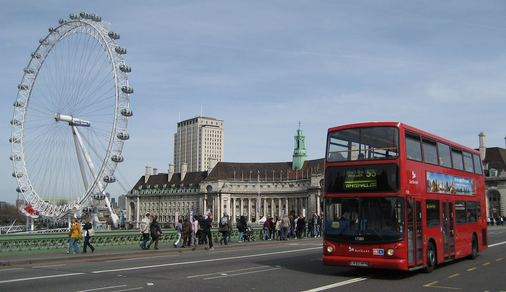 London Eye London Aquarium And A Red Bus On Westminster