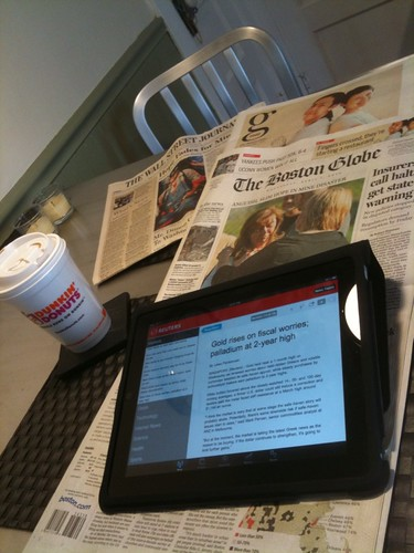 Reading Real Time News on iPad. Unread Newspapers Underneath. | by stevegarfield