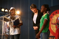 Miss Clark with young Alexandra girl during MDG Song launch | by United Nations Development Programme