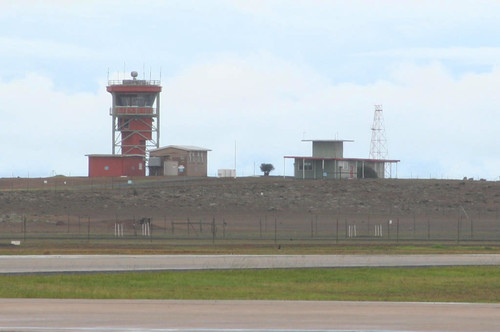 Air traffic control tower on the hill to the south