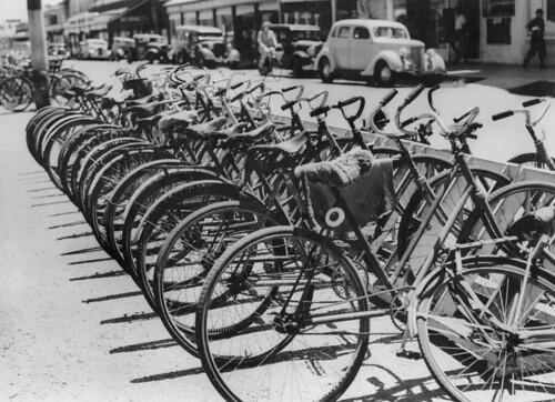 Bicycles parked on the pavement at Mackay, Queensland, 1948 | by State Library of Queensland, Australia
