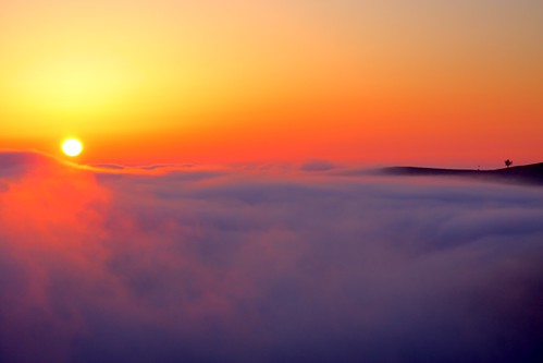 sun rising above fog | by Marc Crumpler (Ilikethenight)