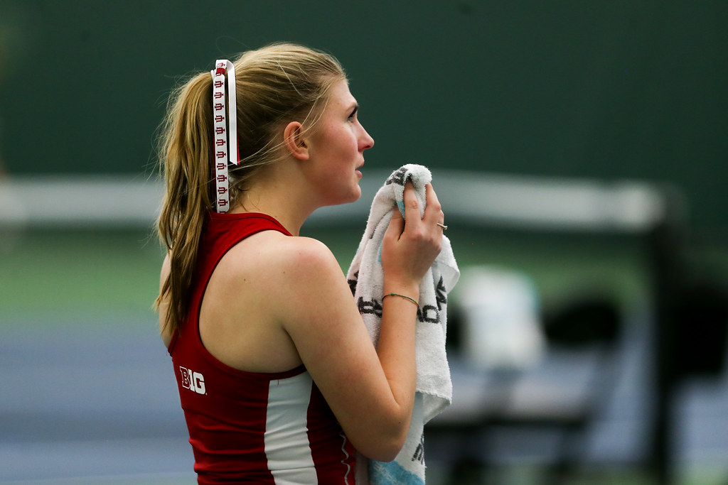 Pauline Jahren cleans her bloodied nose between games.