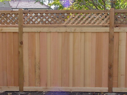 Red Cedar Message Board ~ Western red cedar board over lattice top fence
