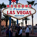 Couple getting married under the welcome to fabulous las vegas sign