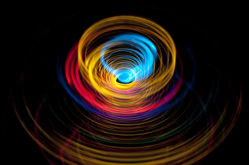 Neon Whirlpool Brightly Coloured Lights Forming A Funnel