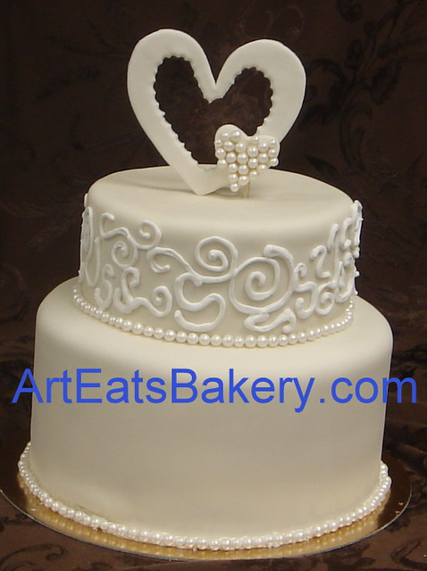 fondant icing wedding cake two tier fondant wedding cake with royal icing curlicues a 14370