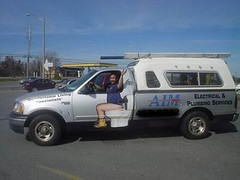 "A plumbing company service vehicle."" Title="