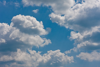 White clouds on a bright blue summer sky | by Horia Varlan