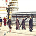 Monks walking along the prayer wheels of the Swayambhunath Stupa