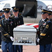 Arizona Guardsmen carry the casket of a fallen Soldier past his family at Luke Air Force Base, Ariz.