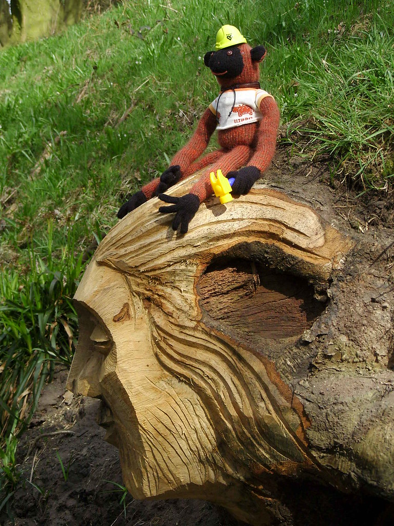 Green bob chainsaw carving of a man by steve