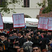 Graduates carrying flags at Commencement