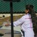 Julie Tumamait-Stenslie sages fountain at Dolphin Fountain Dedication
